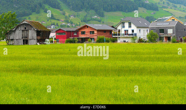 Various housing as a symbol of  difference of tastes, preferences, opportunities. A small village in central Switzerland - Stock-Bilder