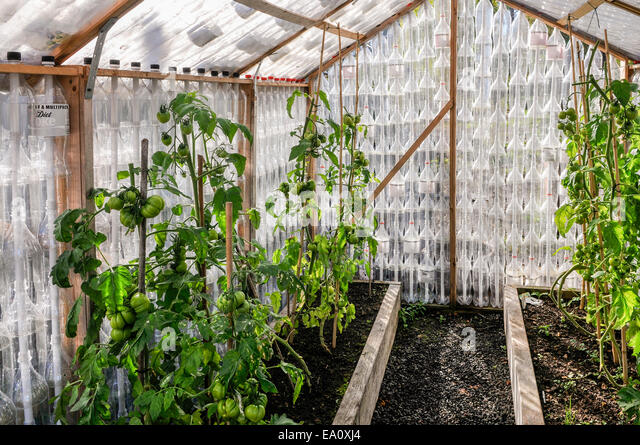 House made of bottles stock photos house made of bottles for What is a greenhouse made out of