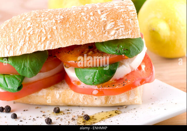 Ciabatta with mozzarella, tomato, basil, pepper and olive oil. - Stock Image
