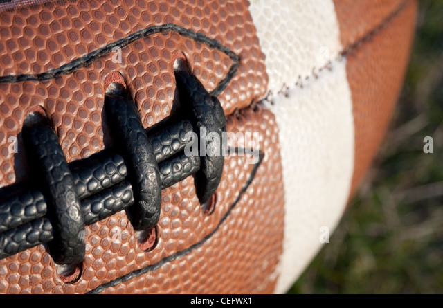 A macro close-up photo of the laces of an American football, sometimes called a 'pigskin' - Stock Image