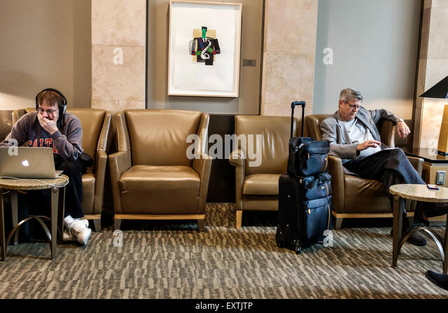 Dallas Texas Dallas Ft. Fort Worth International Airport DFW American Airlines Admirals Club business terminal concourse - Stock Image