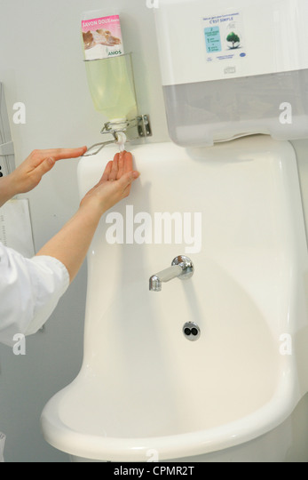 HAND WASHING IN HOSPITAL - Stock Image