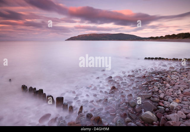 Sunset over Porlock Beach, Exmoor National Park, Somerset, England. Autumn. - Stock Image