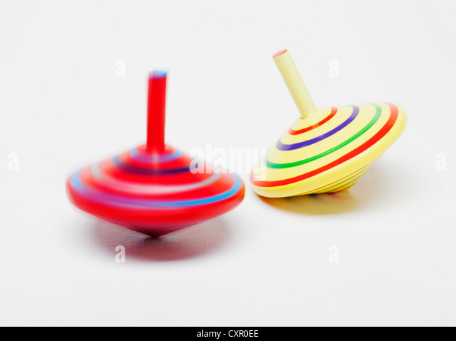 Spinning tops in motion - Stock Image