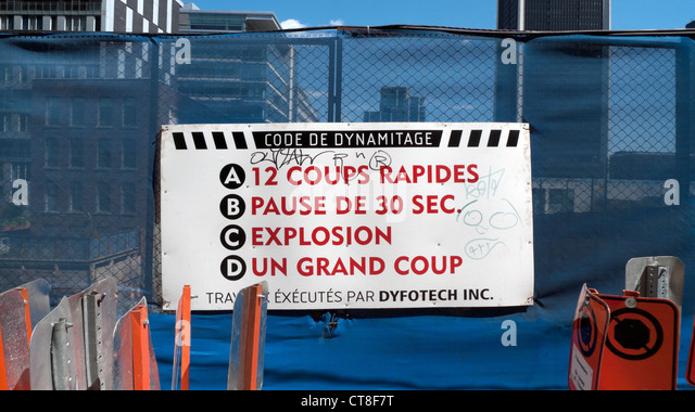 A Dynamite Code sign on a construction site barrier fence in the centre of the city of Montreal, Quebec, Canada - Stock Image