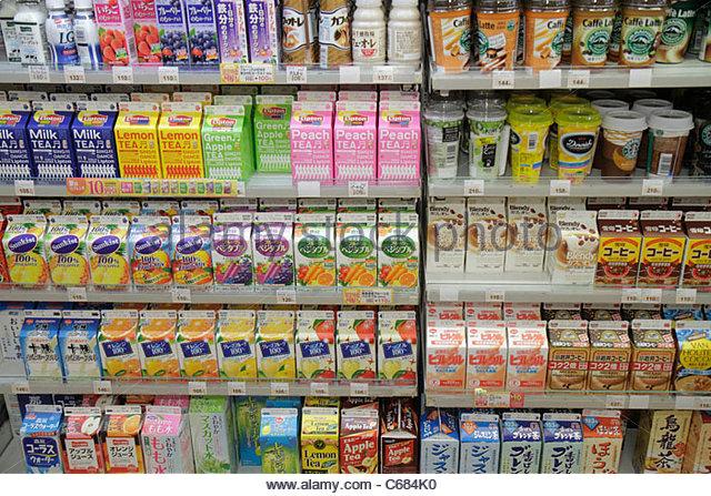 Tokyo Japan Ueno kanji hiragana katakana Japanese English characters symbols sign business Circle K Sunkus Convenience - Stock Image