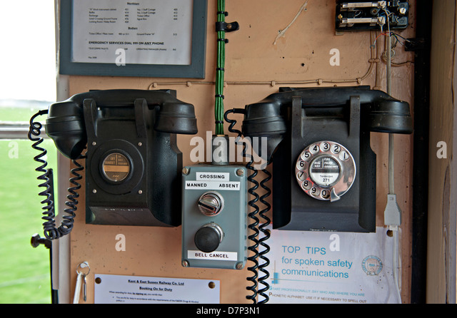Vintage telephones inside the Crossing Keeper's Hut on the Kent and East Sussex Railway, UK - Stock Image