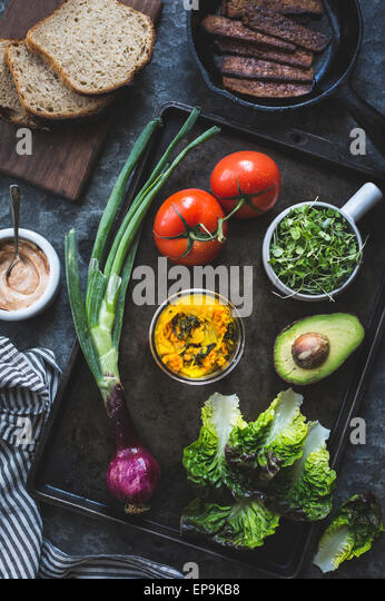 Ingredients for a tempeh BLT sandwich - Stock Image