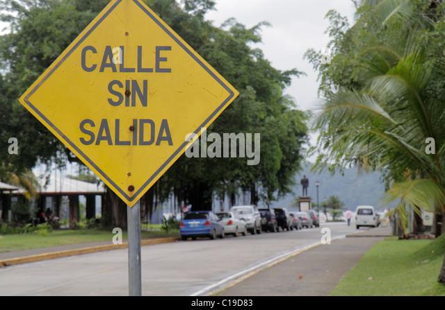 Panama City Panama Amador street scene traffic sign Spanish language no exit dead end diamond shape yellow - Stock Image