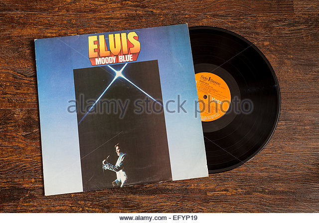 Elvis Presley - Moody Blue album cover and vinyl record - Stock Image