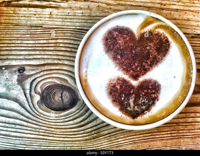 Late art hearts in cappuccino cup - Stock-Bilder