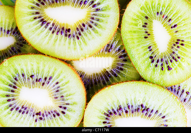 Background from the kiwis cut by rings - Stock Image