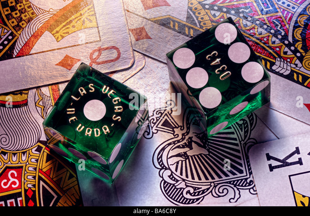 Las Vegas casino dice on playing cards - Stock Image