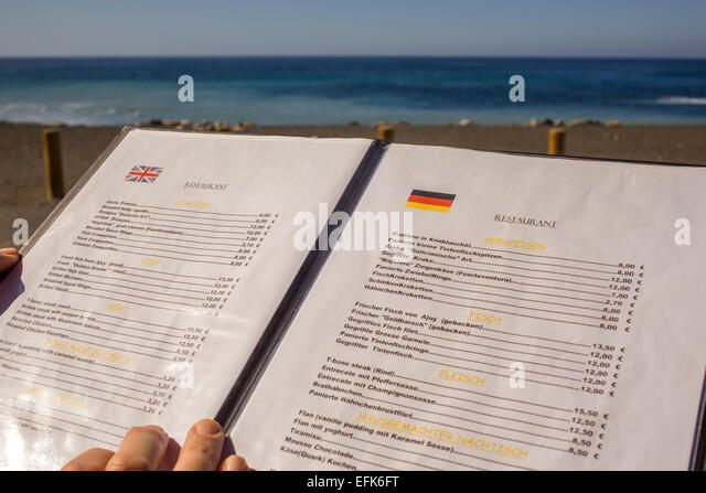 Choosing from the tourist menu in German and English - Stock Image
