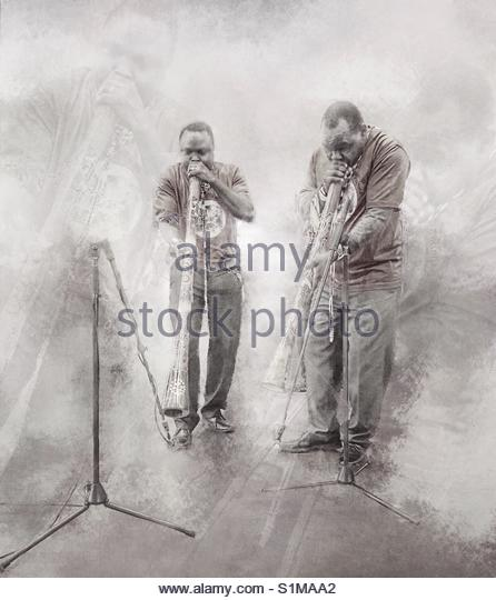 musicians (African musicians playing the African horn trumpet) - Stock Image