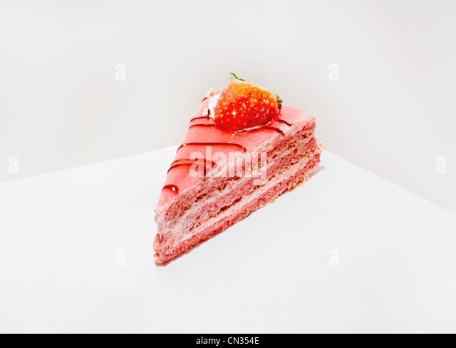 Slice of cake with strawberry - Stock Image