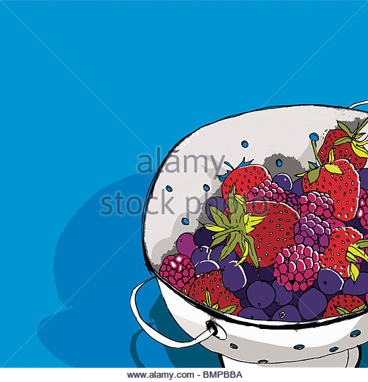 Berries in colander - Stock Image
