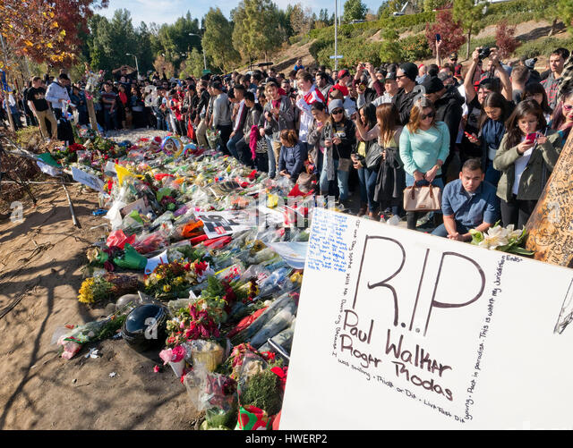 Fans gather by the make shift memorial for actor Paul Walker, star of the 'Fast and The Furious', on December - Stock Image