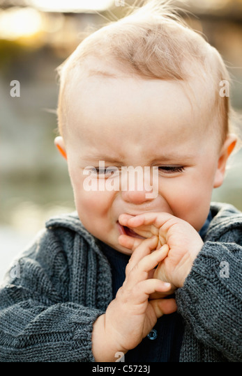 Close up of crying baby - Stock Image