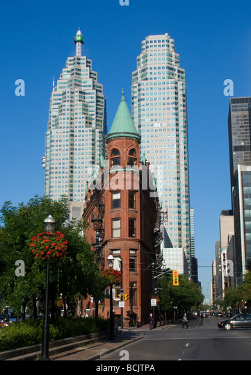 Skyline of Toronto Ontario Canada with Flat Iron building also known as the Gooderham building in the foreground - Stock Image