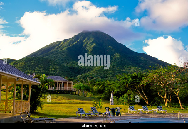 Mount Nevis, green volcano peak, open fields, Island of Nevis, St Kitts and Nevis, Caribbean, clear blue sky background - Stock Image