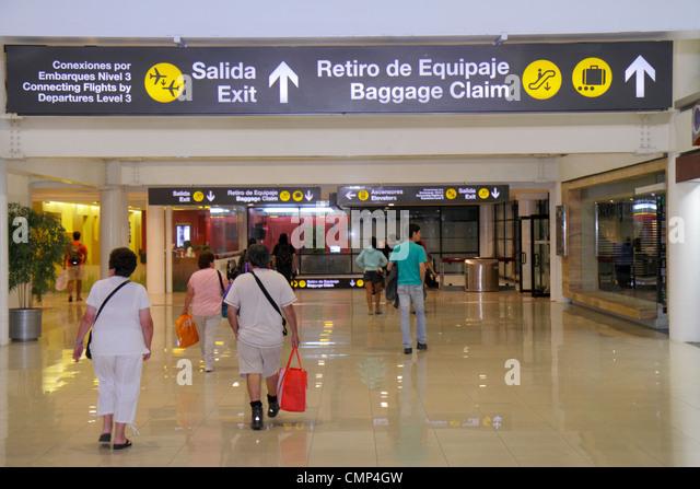 Chile Santiago Comodoro Arturo Merino Benítez International Airport aviation terminal concourse sign direction - Stock Image