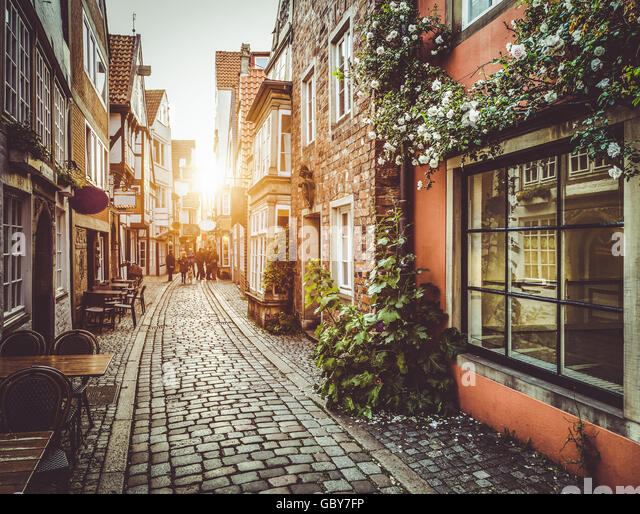 Enchanting old town in Europe in beautiful golden evening light at sunset in summer with retro vintage Instagram - Stock Image
