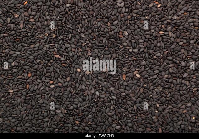 Closeup of lots of black sesame seeds - Stock Image