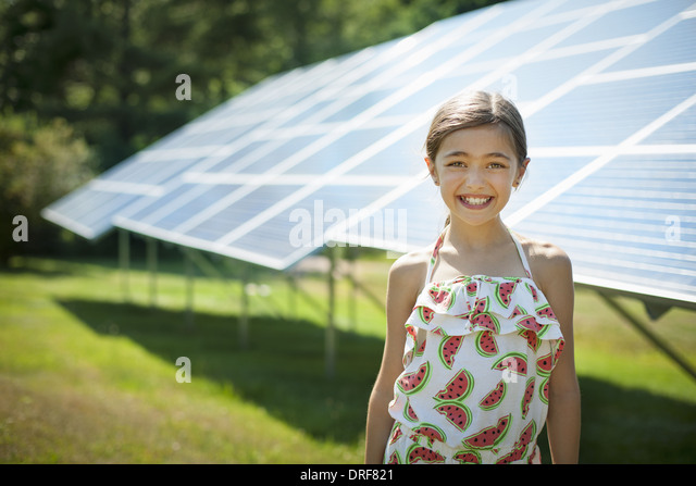 New York state USA child in fresh air on sunny day solar panels - Stock Image