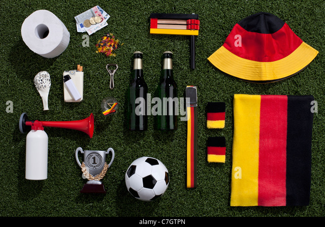 Sporting equipment and accessories arranged on turf - Stock Image