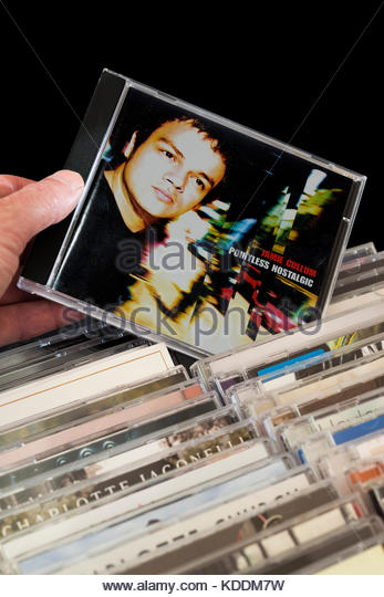 Pointless Nostalgic, Jamie Cullum CD being chosen from among rows of other CD's Dorset, England - Stock Image