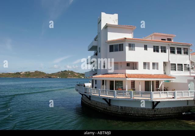 Sint Maarten Simpson Bay Lagoon Saint Martin beyond Dutch French waterfront house - Stock Image