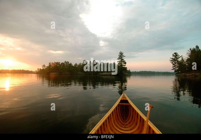 Canoe Prow, Sunrise, Kahshe Lake, Muskoka, Ontario - Stock Image