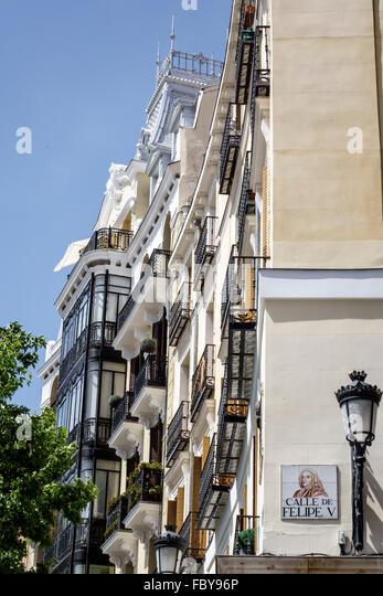 Madrid Spain Europe Spanish Hispanic Centro Plaza de Oriente apartment building balconies Calle Felipe V street - Stock Image