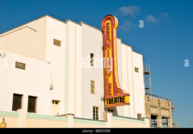 Art Deco building Homestead Fl Florida old Seminole red yellow movie theater sign - Stock Image