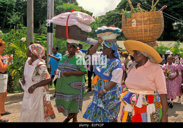 Caribbean women wearing baskets and laundry on their heads at the Tobago Heritage Festival a  Caribbean cultural - Stock Image