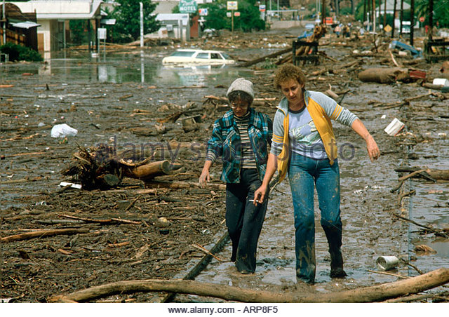 Flood in Clifton Arizona 1983 Residents of  Clifton walk down main street in Clifton  Arizona the day after the - Stock Image