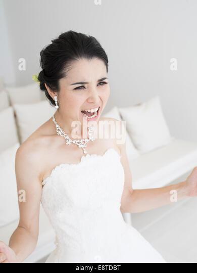 Bridezilla!  Angry bride in white wedding dress - Stock Image