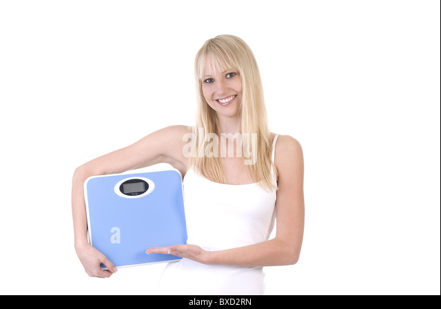 Contented woman with scale - Stock Image