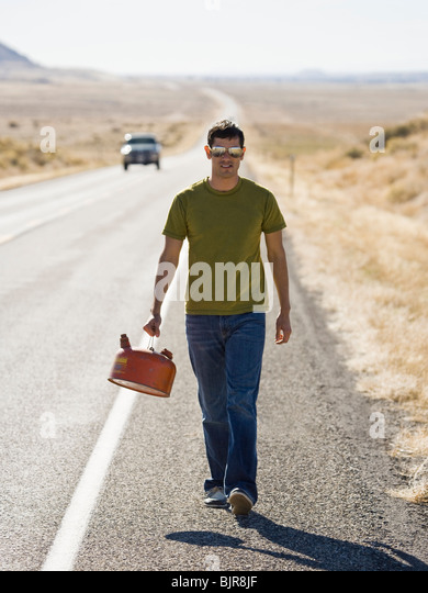 man walking with a gas can - Stock-Bilder