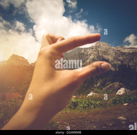 Woman Hand scaling mountain height from camping Travel Lifestyle concept Summer journey vacations outdoor - Stock Image