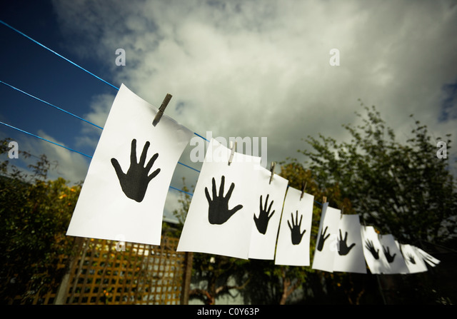 Hands on washing line. - Stock-Bilder