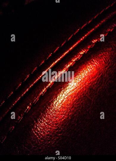 Stitching on the arm of a leather sofa. - Stock-Bilder