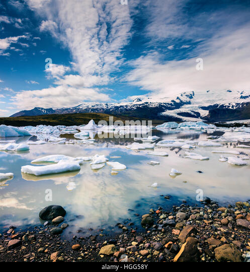Floating ice box on the Fjallsarlon glacial lagoon. Sunny morning in Vatnajokull National Park, southeast Iceland, - Stock Image
