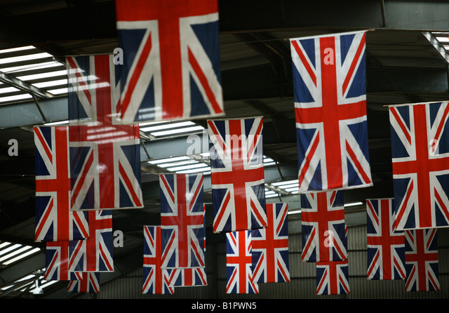 Union Jack Flags hang in the QE2 terminal in Southampton docks - Stock-Bilder