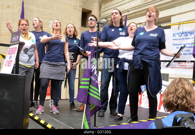 Department Health,Whitehall,London,UK.NHS choir perform.Nurses protest outside Richmond House Department Health - Stock Image