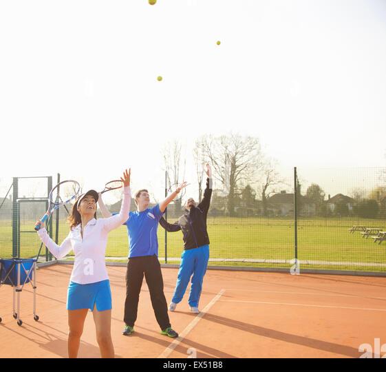 People Practicing Tennis - Stock Image
