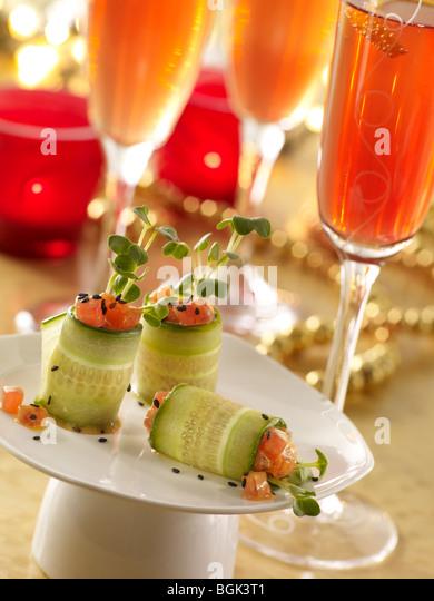 Ahi tuna cucumber rolls with pomegranate prosecco - Stock Image