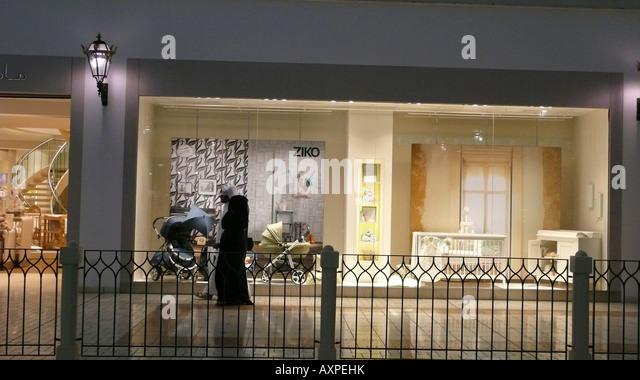 Qatari woman in shopping mall Doha - Stock Image