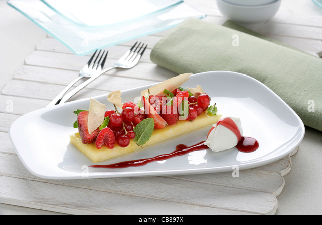 Polenta with red fruits and cheese ice - Stock Image